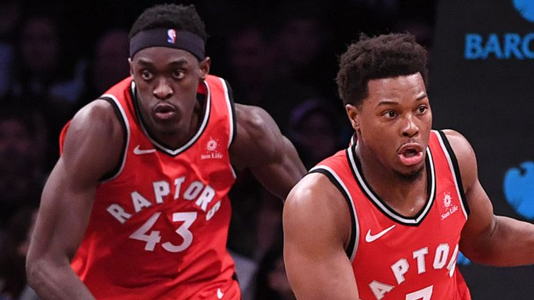 Kyle Lowry leads the Raptors fast break with Pascal Siakam close behind