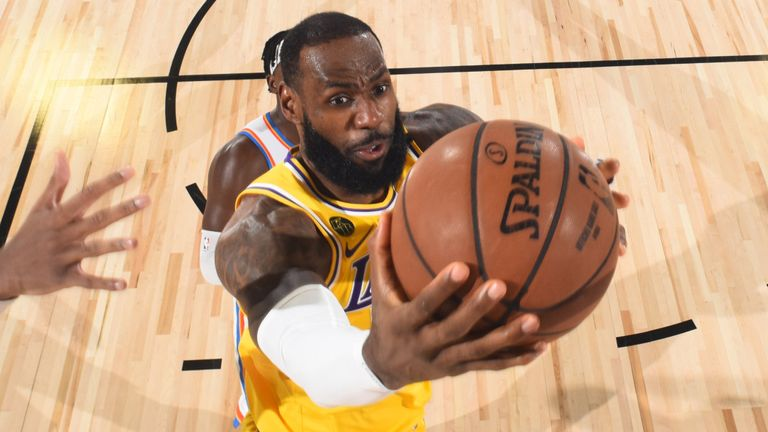 LeBron James drives to the basket in the Lakers' loss to the Thunder