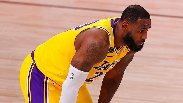 LeBron James gets set to play defense in the Lakers' Game 1 loss to the Portland Trail Blazers