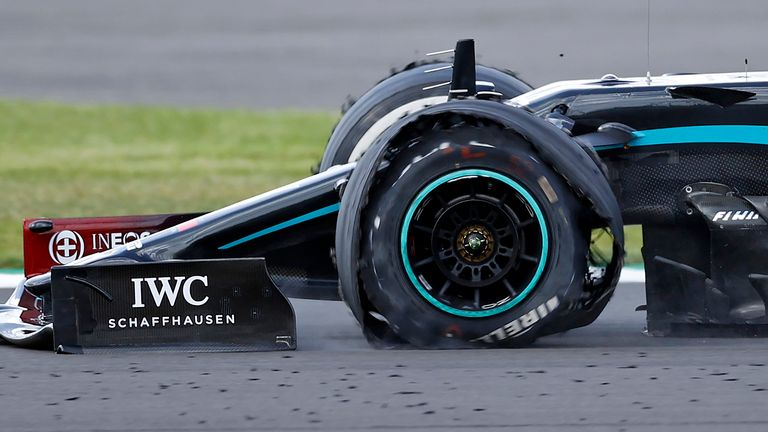 The punctured tyre of Mercedes' British driver Lewis Hamilton punctures is pictured as he goes on to win the Formula One British Grand Prix at the Silverstone motor racing circuit in Silverstone, central England on August 2, 2020.