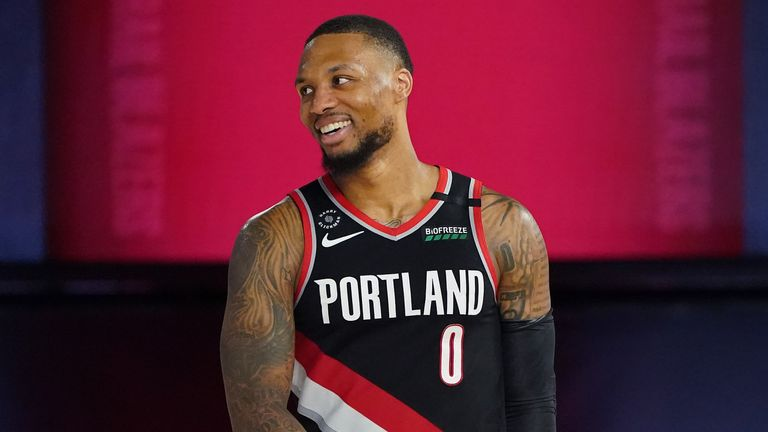 Damian Lillard of the Portland Trail Blazers smiles and celebrates after the Western Conference Play in Game against the Memphis Grizzlies