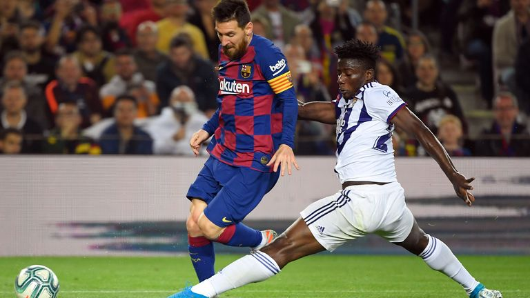 Salisu tackling Barcelona's Lionel Messi while playing for Valladolid