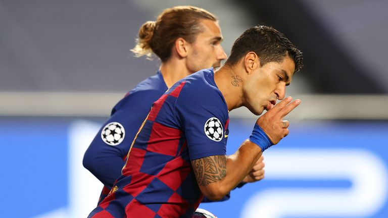 Luis Suarez celebrates after scoring for Barcelona against Bayern Munich