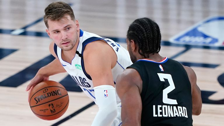 Luka Doncic is guarded by Kawhi Leonard in Game 2