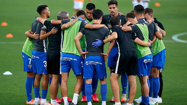 Players of Malaga CF during the prematch warm up prior to the La Liga Smartbank match between Malaga CF and Extremadura UD at Estadio La Rosaleda on June 20, 2020