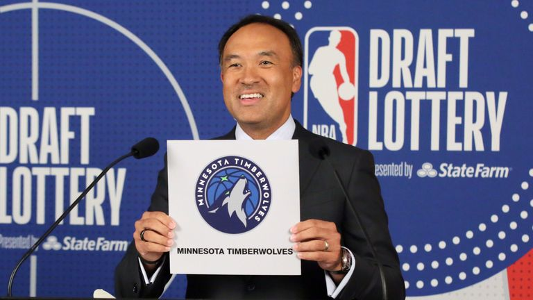 Deputy commissioner of the NBA Mark Tatum holds up the card of the Minnesota Timberwolves to confirm they get the No 1 pick in the 2020 Draft