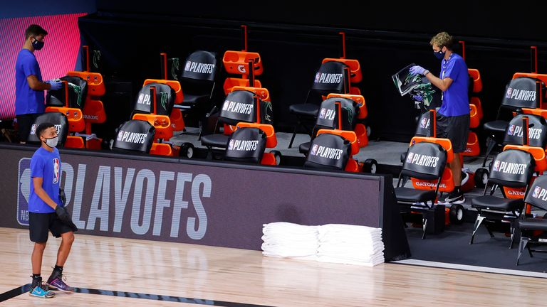 Milwaukee Bucks sideline jerseys are removed from the bench following their decision to boycott Game 5