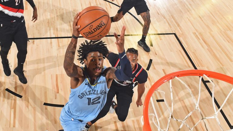 Ja Morant of the Memphis Grizzlies dunks the ball against the Portland Trail Blazers