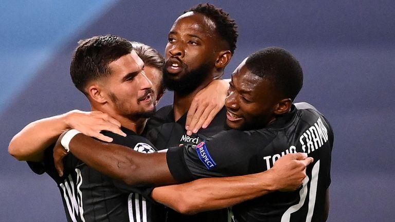 Moussa Dembele celebrates scoring for Lyon vs Man City