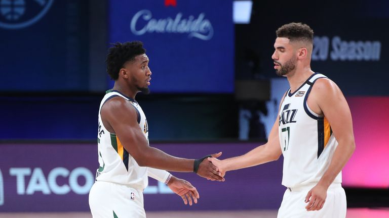 Donovan Mitchell's acrobatic assist enabled Georges Niang to sink a three-pointer for Utah against Denver in their NBA playoff encounter.