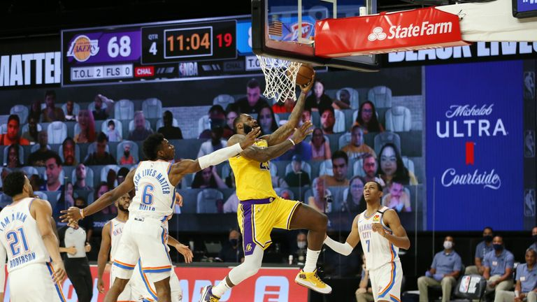 LeBron James went the length of the court as he completes and-one in the fourth quarter of the Lakers NBA encounter with OKC.
