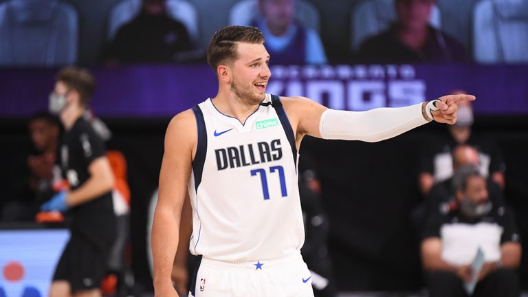 A Luka Doncic triple-double saw the Dallas Mavericks edge out the Sacramento Kings 114-110 in overtime.