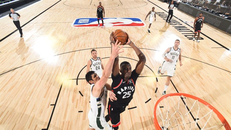 Chris Boucher powered home his dunk shot as Toronto extended their lead over Milwaukee in the fourth quarter of their NBA clash.