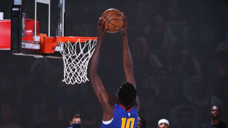 Bol Bol #10 of the Denver Nuggets dunks the ball against the LA Clippers on August 12, 2020 at the AdventHealth Arena at in Orlando, Florida.