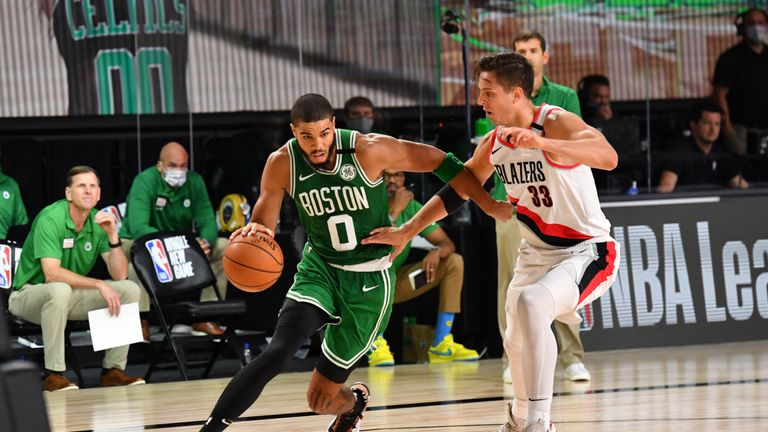 Jayson Tatum #0 of the Boston Celtics handles the ball against Zach Collins #33 of the Portland Trail Blazers on August 2, 2020 at The Arena at ESPN Wide World Of Sports Complex in Orlando, Florida.