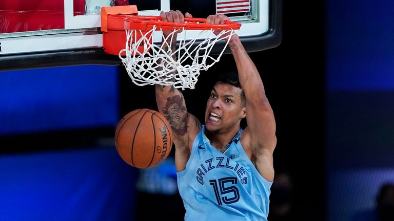 Memphis Grizzlies' Brandon Clarke #15 dunks against the San Antonio Spurs during the first half of an NBA basketball game at Visa Athletic Center at ESPN Wide World Of Sports Complex on August 2, 2020 in Lake Buena Vista, Florida.