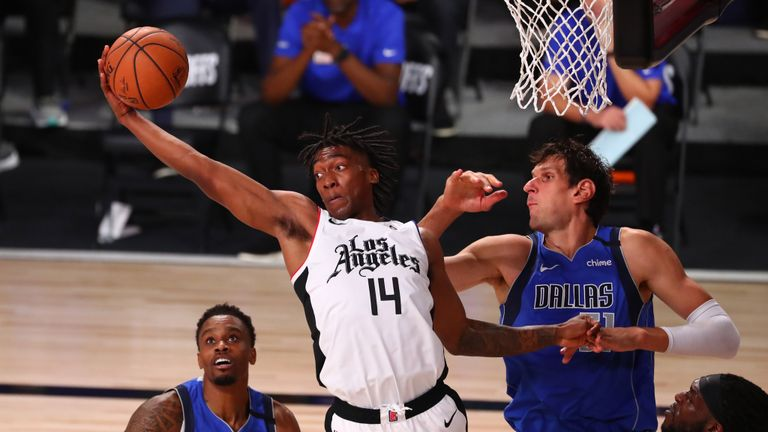 Terance Mann #14 of the Los Angeles Clippers grabs a rebound against Boban Marjanovic #51 of the Dallas Mavericks in the second half in game five of the first round of the 2020 NBA Playoffs at ESPN Wide World Of Sports Complex on August 25, 2020 in Lake Buena Vista, Florida.