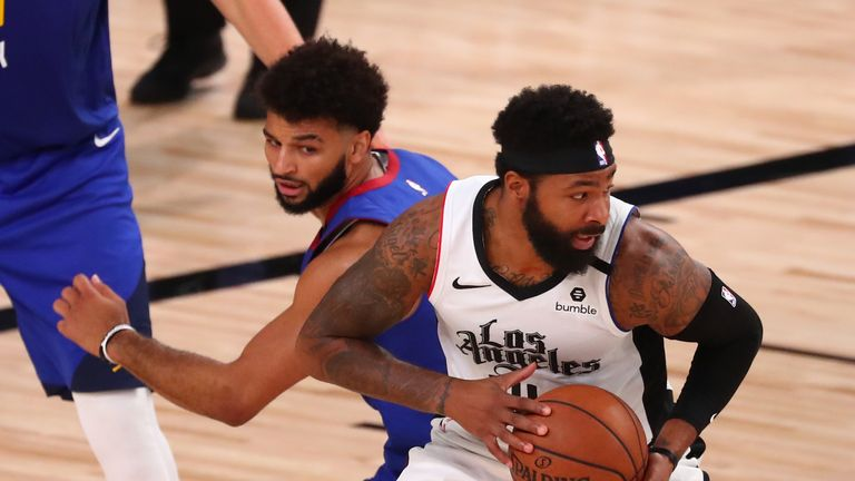 Marcus Morris Sr. #31 of the LA Clippers is guarded by Jamal Murray #27 of the Denver Nuggets in the third quarter at AdventHealth Arena at ESPN Wide World Of Sports Complex on August 12, 2020 in Lake Buena Vista, Florida.