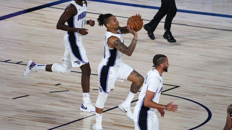 Markelle Fultz #20 of the Orlando Magic makes a three-point basket to end the first quarter of a NBA basketball game against the Sacramento Kings at HP Field House at ESPN Wide World Of Sports Complex on August 2, 2020 in Lake Buena Vista, Florida.