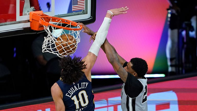 Rudy Gay #22 of the San Antonio Spurs dunks the ball as he gets past Jaxson Hayes #10 of the New Orleans Pelicans during the second half at HP Field House at ESPN Wide World Of Sports Complex on August 9, 2020 in Lake Buena Vista, Florida.