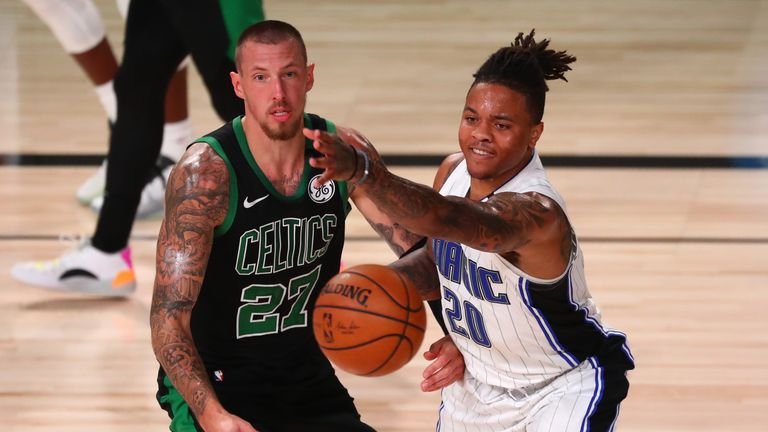Markelle Fultz #20 of the Orlando Magic chases the ball with Daniel Theis #27 of the Boston Celtics during overtime of a NBA basketball game at AdventHealth Arena at the ESPN Wide World Of Sports Complex on August 9, 2020 in Lake Buena Vista, Florida.