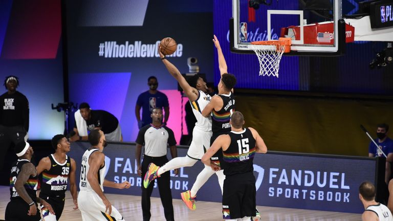 Donovan Mitchell #45 of the Utah Jazz dunks the ball against the Denver Nuggets during Round One, Game Five of the NBA Playoffs on August 25, 2020 at The Field House in Orlando, Florida.