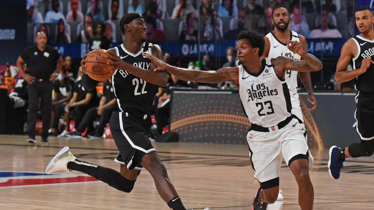 Caris LeVert #22 of the Brooklyn Nets drives to the basket around Lou Williams #23 of the LA Clippers on August 9, 2020 in Orlando, Florida at AdventHealth Arena.