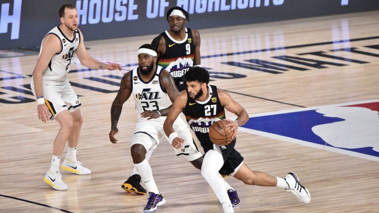 Jamal Murray #27 of the Denver Nuggets drives to the basket against the Utah Jazz during Round One, Game Five of the NBA Playoffs on August 25, 2020 at The Field House in Orlando, Florida.