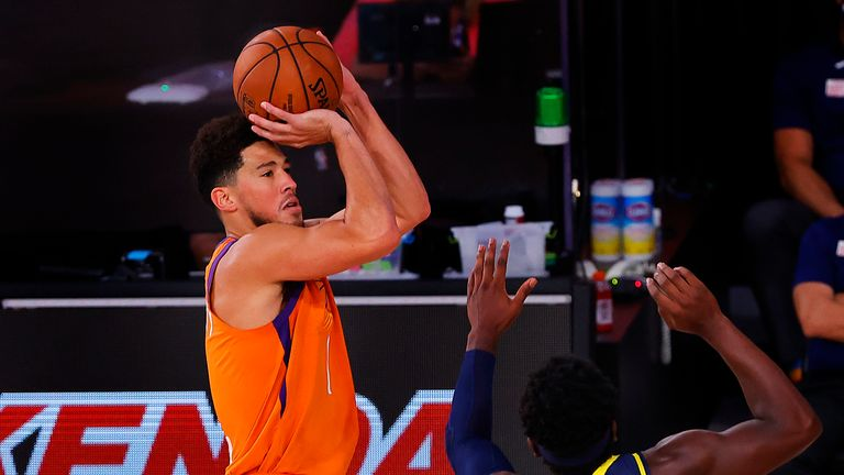 Devin Booker #1 of the Phoenix Suns attempts a three point basket as Aaron Holiday #3 of the Indiana Pacers defends at Visa Athletic Center at ESPN Wide World Of Sports Complex on August 06, 2020 in Lake Buena Vista, Florida.