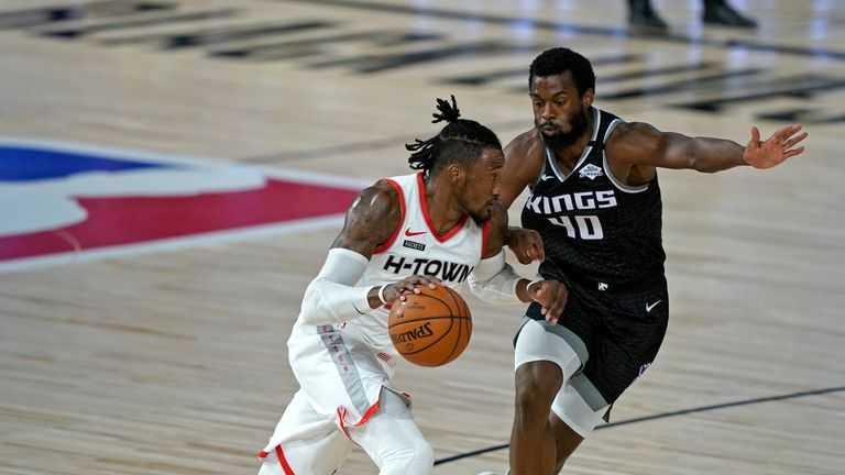 Robert Covington #33 of the Houston Rockets drives around Harrison Barnes #40 of the Sacramento Kings during the first half at HP Field House at ESPN Wide World Of Sports Complex on August 9, 2020 in Lake Buena Vista, Florida.