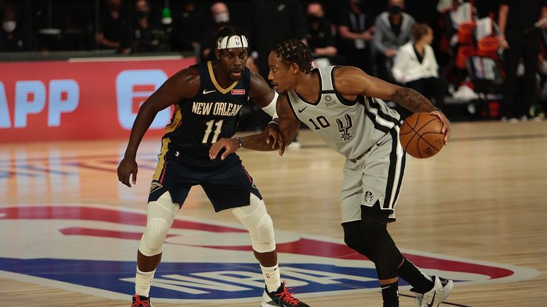 Jrue Holiday of the New Orleans Pelicans defends against DeMar DeRozan of the San Antonio Spurs as part of the NBA Restart 2020 on August 9, 2020 at The Field House at ESPN Wide World of Sports Complex in Orlando, Florida.