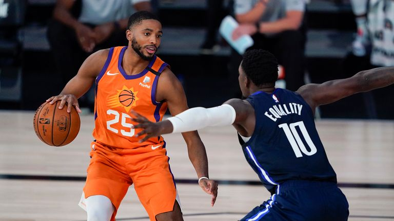 Mikal Bridges #25 of the Phoenix Suns looks to drive against Dorian Finney-Smith #10 of the Dallas Mavericks during the second half at Visa Athletic Center at ESPN Wide World Of Sports Complex on August 2, 2020 in Lake Buena Vista, Florida.