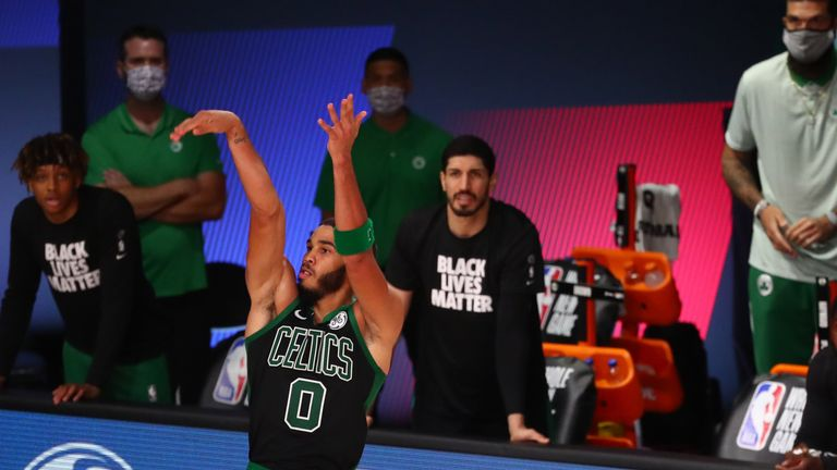 Jayson Tatum #0 of the Boston Celtics ties the game in the fourth quarter of a NBA basketball game against the Orlando Magic at AdventHealth Arena at the ESPN Wide World Of Sports Complex on August 9, 2020 in Lake Buena Vista, Florida.