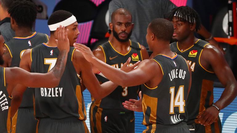 The Thunder players celebrate their victory over the Washington Wizards