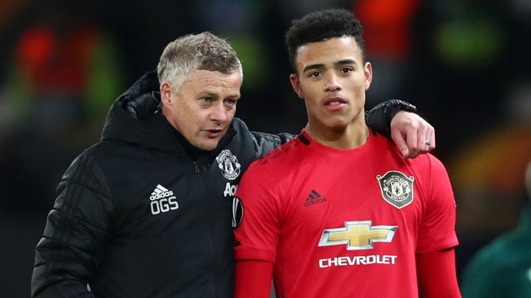 Ole Gunnar Solskjaer speaks to Mason Greenwood following Manchester United's win over Club Brugge in the UEFA Europa League round of 32 second leg