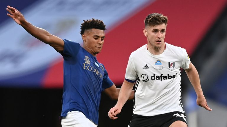 Ollie Watkins challenges Tom Cairney during the Championship play-off final