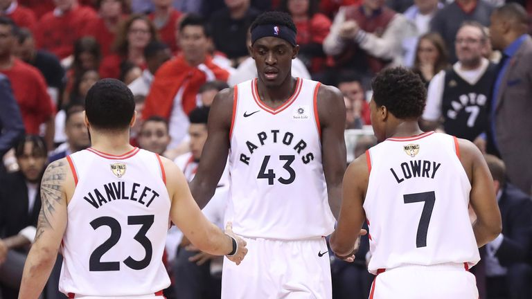 Pascal Siakam is congratulated by Kyle Lowry and Fred VanVleet
