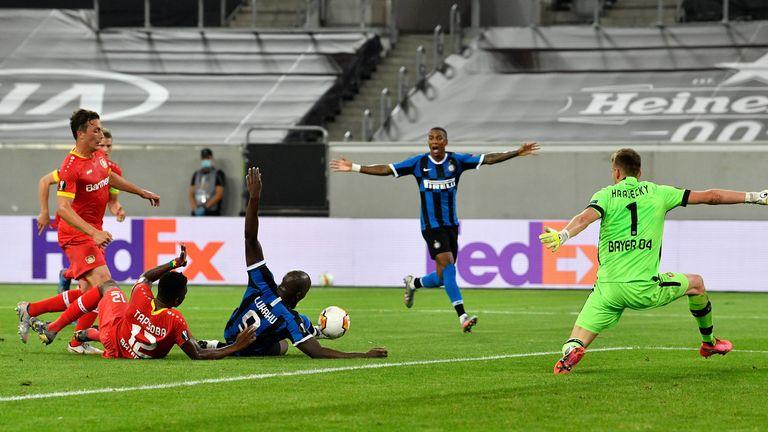 Lukaku still manages to score despite being challenged by Edmond Tapsoba