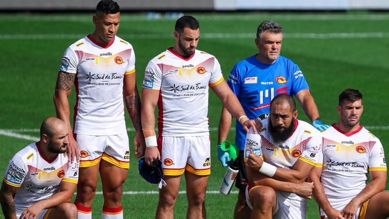 Folau (second left) and Benjamin Jullien (third left) stand up as their team-mates take a knee in support of the Black Lives Matter movement