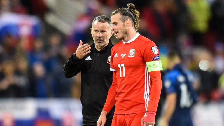 Ryan Giggs head coach of Wales and Gareth Bale talk after the UEFA Euro 2020 qualifier between Slovakia and Wales on October 10, 2019 in Trnava, Slovakia.