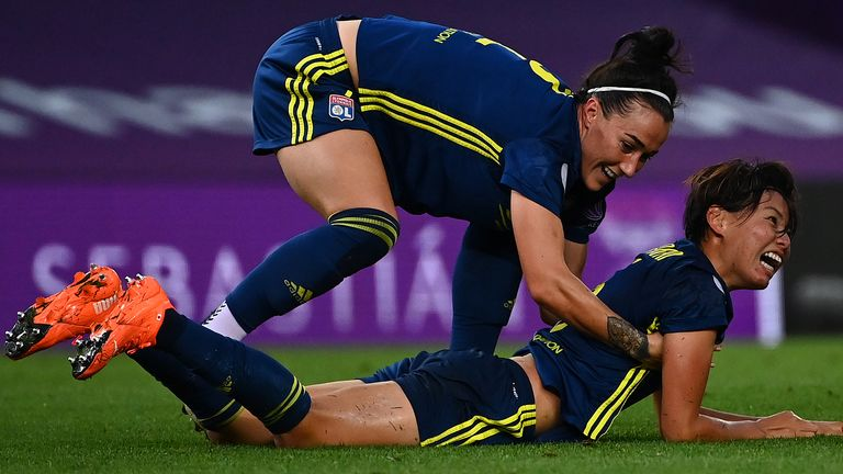 Lucy Bronze celebrates with Saki Kumagai