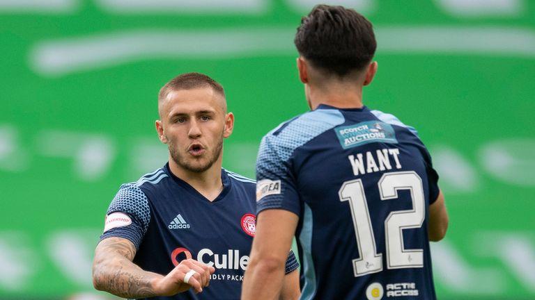 Hamilton's Scott Martin celebrates his goal against Celtic with Shaun Want