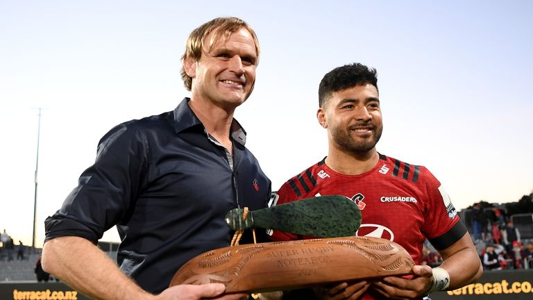 Richie Mo'unga and Crusaders head coach Scott Robertson with the Super Rugby Aotearoa trophy
