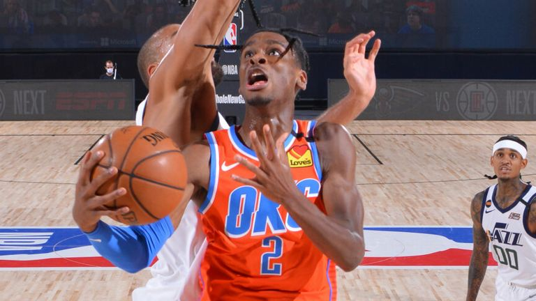 Shai Gilegoues-Alexander attacks the basket against the Utah Jazz