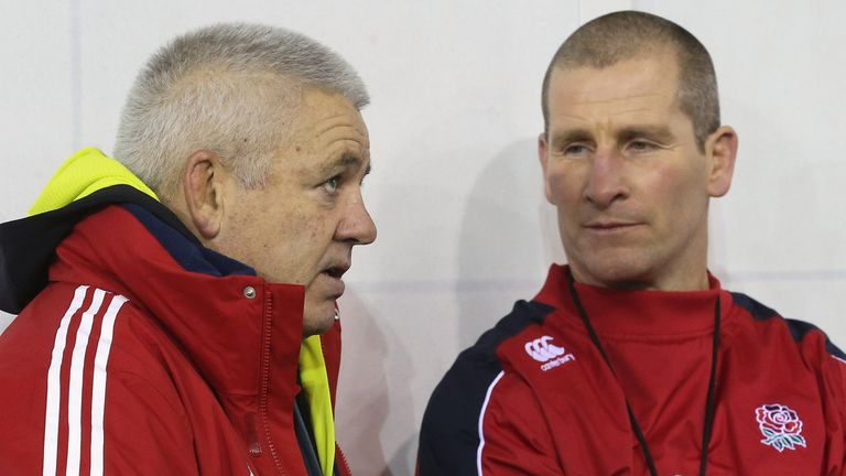 Warren Gatland (L) the British and Irish Lions head coach talks to England head coach Stuart Lancaster during the England training session held at St Georges Park on February 13, 2013 in Burton-upon-Trent, England