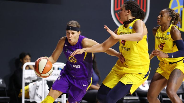 Sydney Wiese of the Los Angeles Sparks drives to the basket against the Indiana Fever