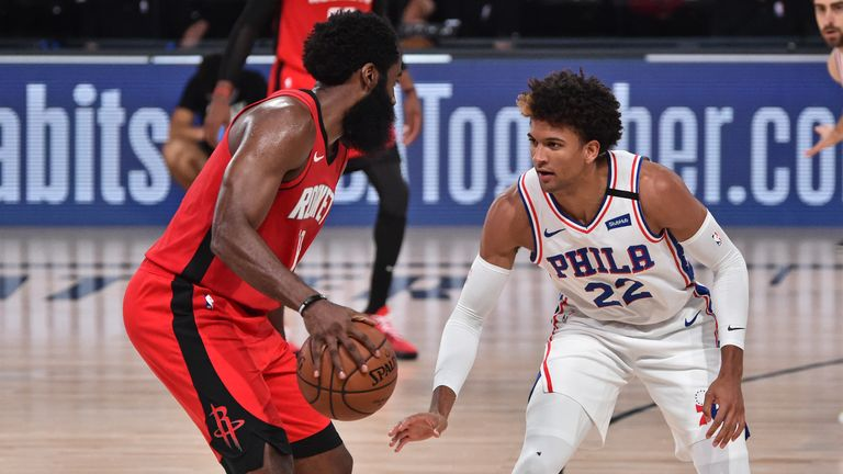 Matisse Thybulle of the Philadelphia 76ers plays defense on James Harden of the Houston Rockets