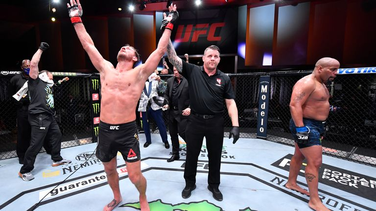 Stipe Miocic celebrates after his victory over Daniel Cormier in their UFC heavyweight fight in Las Vegas