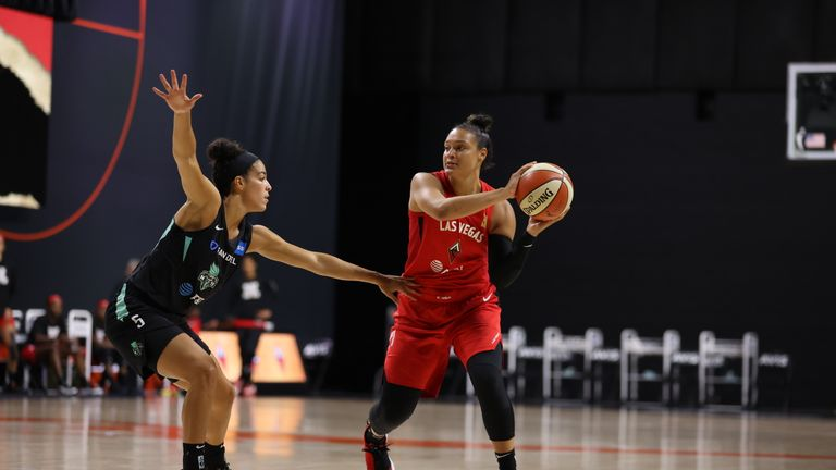 Liz Cambage #8 of the Las Vegas Aces looks to pass against Kia Nurse #5 of the New York Liberty during a game on August 9, 2020 at Feld Entertainment Center in Palmetto, Florida.