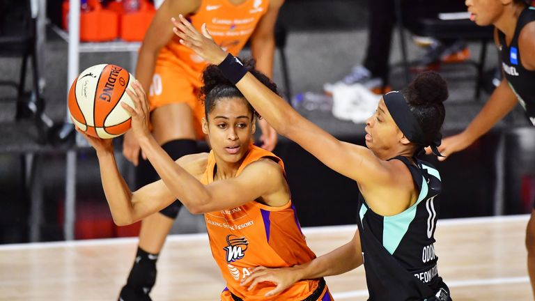 Skylar Diggins-Smith #4 of the Phoenix Mercury looks to pass the ball around Leaonna Odom #0 of the New York Liberty during the first half of a game at Feld Entertainment Center on August 02, 2020 in Palmetto, Florida.